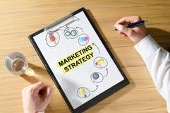 Marketing strategy concept on a desk. Marketing strategy concept on a clipboard royalty free stock image