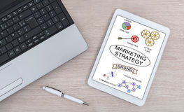 Marketing strategy concept on a digital tablet. Marketing strategy concept shown on a digital tablet Royalty Free Stock Photo