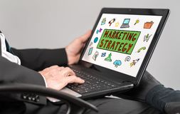 Marketing strategy concept on a laptop. Businessman watching marketing strategy concept on a laptop Royalty Free Stock Photo