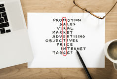 Marketing strategy plan. Crossword puzzle on the office desk royalty free stock image