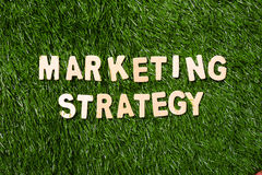 Marketing Strategy Wooden Sign On Grass Royalty Free Stock Photography