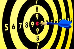 Marketing and success. Dart hitting the center of the dartboard exactly like someone would center his/her objective, or the needs of the clients Stock Image