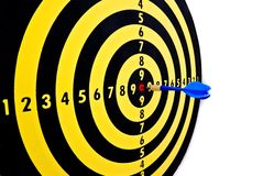 Marketing and success. Dart hitting the center of the dartboard exactly like someone would center his/her objective, or the needs of the clients Stock Photography