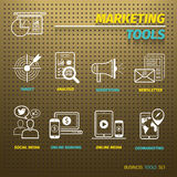 Marketing Tools on Brown Pegboard. With icons set Stock Photos