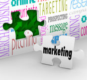 Marketing Wall Puzzle Piece Market Plan Strategy. A puzzle piece with the word Marketing is your final answer completing your strategy to growing your business Stock Photography