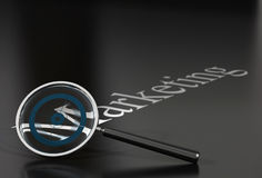 Marketing word and magnifier Stock Photography