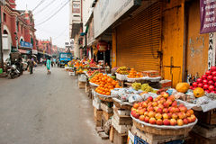 Marketplace with fresh fruits stall in a dirty street of old city Stock Images