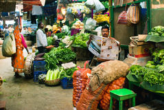 Marketplace with fresh grocery and poor customers of indian city Royalty Free Stock Photo