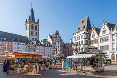 Marketplace in Trier. Trier, GERMANY - MARCH 03: Marketplace in Trier with its colourful stalls with merchants selling flowers and souvenirs. March 03, 2014 in Stock Photos