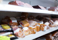 Marketplace with vacuum meat products Stock Images