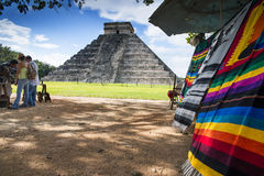 Markets in chichen-itza. The beautiful pyramid of Chichen-itza with some tourists while buying traditional mayan products Stock Images