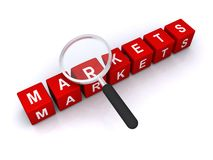 Markets. A concept illustration of markets with a magnifying glass over letter blocks forming the word Stock Images