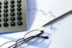 Markets Go Down. Financial chart, market's falling, calculator, pen, glasses Stock Image