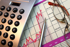 Markets Go Up, Financial Chart. Financial chart, market's rising, calculator, pen, glasses Royalty Free Stock Image