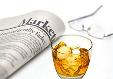 Markets newspaper with whiskey Stock Photos
