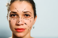 Markiertes Gesicht für Schönheitsoperation Lizenzfreie Stockfotografie