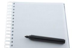 Markierung auf dem Notizbuch Stockbild