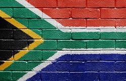 Markierungsfahne von Südafrika auf Backsteinmauer Lizenzfreies Stockbild