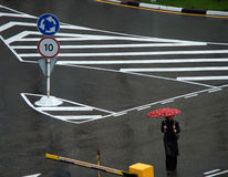 Marking. Women under umbrella and road marking Royalty Free Stock Photos
