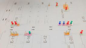 Marking area on white layout paper with colorful of push pin. And copy space Royalty Free Stock Photos