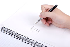 Marking a check box. A hand marking a check box on white background Royalty Free Stock Images