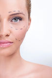 Marking for cosmetic plastic surgery. Lines on an attractive Caucasian lady face as marks for cosmetic plastic surgery Stock Photography