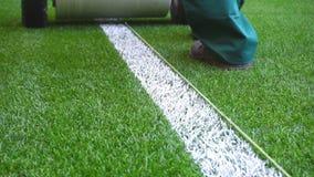 Marking football stadium field with paint stock footage