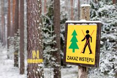 Marking of forestry service in the field. A sign prohibiting entry into the forest on a seed bed. stock image