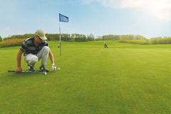 Marking golf ball position on the green Stock Image