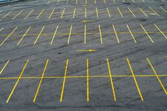 The marking lines in the parking lot with yellow paint on asphalt royalty free stock images