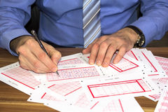 Marking lottery ticket Royalty Free Stock Images