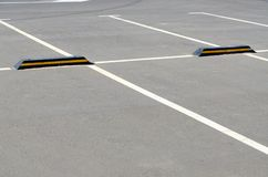 Marking of parking spaces at supermarket. The white road marking of the parking spaces at the supermarket royalty free stock photography