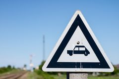 Marking on railway tracks near the passage for cars. Signs used Stock Images