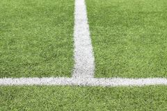 Marking white paint on a green grass of the football field stock images
