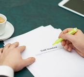 Marking words in a gold standart definition Royalty Free Stock Photo