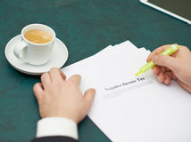 Marking words in a negative income tax definition Royalty Free Stock Image