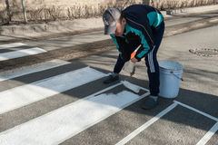 Marking work on arrangement of the pedestrian crossing stock photography