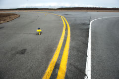 Marking yellow runway of a small airfield. Royalty Free Stock Image