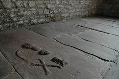 Ancient grave markings inside Scottish chapel. Markings on an ancient grave in a chapel floor, with various symbols used Royalty Free Stock Image