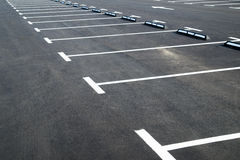 Markings on asphalt pavement indicating parking spaces Royalty Free Stock Image