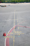 Markings on the concrete at the airport Stock Images