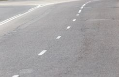 Markings on the road as a background. texture.  Stock Photos