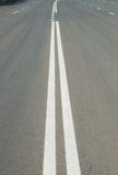 Markings on the road double solid line Royalty Free Stock Photography