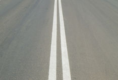 Markings on the road double solid line Stock Photography
