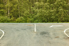 Markings to give way to the car. The departure on the main road in the woods Royalty Free Stock Image