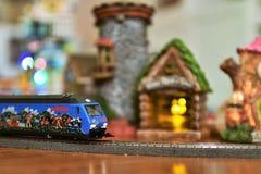 Marklin Alpine Train passing through fairy village stock photography