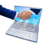 marknadsföring för handskakning för affärsdator Arkivfoton