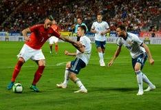 Marko Arnautovic tegen Russische spelers Daler Kuzyaev en Vladimir Granat stock foto's