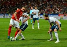 Marko Arnautovic tegen Russische spelers Daler Kuzyaev en Vladimir Granat stock afbeelding