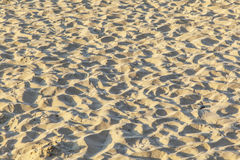 Marks of feet at the beach Stock Photos